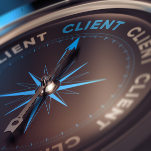 Compass with needle pointing the word client